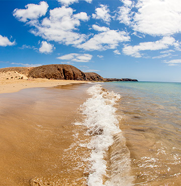 Crystal clear waters and golden sands at Papagayo Beach