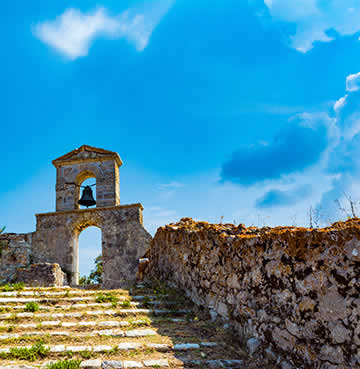Old Bell Tower and crumbling walls, remnants of historical ruins in Lefkas