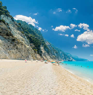 Powder-white sands and towering limestone cliffs at Porto Katsiki, Lefkas