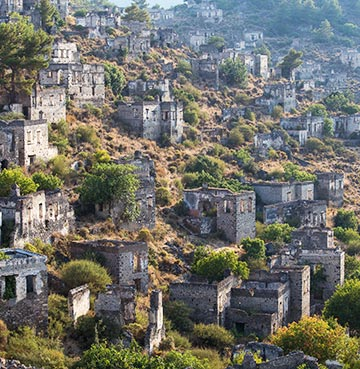 Stone houses of the abandoned village of Kayakoy in the Dalaman Region