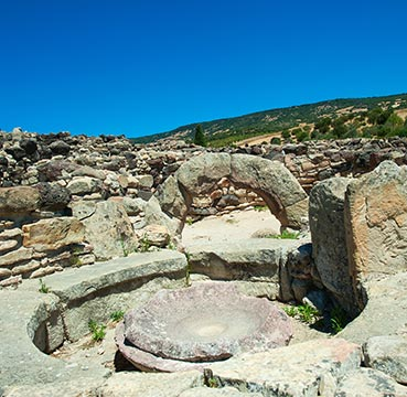 The ruins of Nuraghi, Bronze Age buildings that resemble bee-hives.