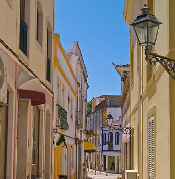 Winding alleyways of a traditional fishing village in the Algarve