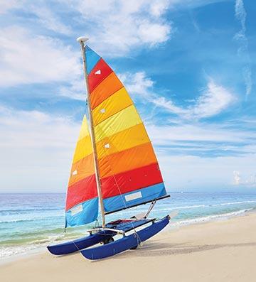 Small sailing boat on Florida beach