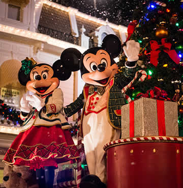 Mickey Mouse and Minnie Mouse dressed up in Christmas themed costumes on a float as part of Mickey's Very Merry Christmas Party parade in Magic Kingdom, Walt Disney World Resort, Florida