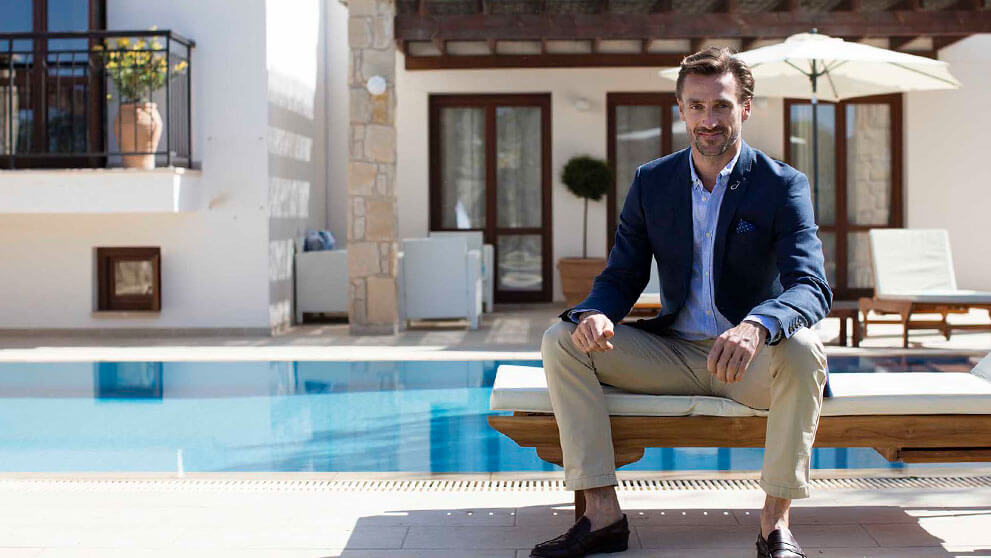 Villa manager by the pool at a villa