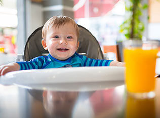 Baby in highchair at the table